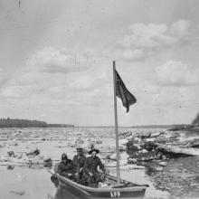 Alberta Provincial Police patrolling the Peace River in a boat, near Fort Vermilion. Date: May 1924. <BR />Photo A13834