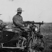 View of the Drunmeller police motorcycle and side car used during labour disputes. Policemen unidentified. Date: [between 1923 and 1924]. <BR />Photo A4814